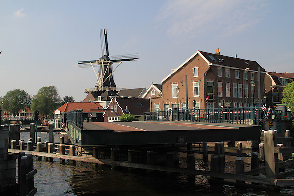 Bridge over the Spaarne River and the De Adriaan Windmill Museum Haarlem, Holland, Netherlands.