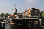 Bridge over the Spaarne River and the De Adriaan Windmill Museum Haarlem, Holland, Netherlands.