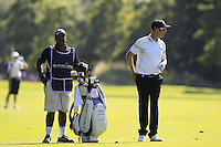 Mikko Ilonen (FIN) and caddy Reggie wait to play his 2nd shot on the 18th hole during Friday's Round 2 of the 2014 Irish Open held at Fota Island Resort, Cork, Ireland. 20th June 2014.<br /> Picture: Eoin Clarke www.golffile.ie