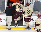 Bert Lenz (BC - Director, Sports Medicine), Bill Arnold (BC - 24), Patch Alber (BC - 3) - The Boston College Eagles defeated the visiting University of Vermont Catamounts to sweep their quarterfinal matchup on Saturday, March 16, 2013, at Kelley Rink in Conte Forum in Chestnut Hill, Massachusetts.