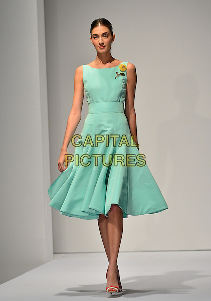 MIAMI, FL - FEBRUARY 13: Models walk the runway during an Oscar De La Renta fashion show Benefiting Cancer Center on February 13, 2014 in Miami, Florida.  &copy;<br /> CAP/MPI/MPI10<br /> &copy;MPI10/MPI/Capital Pictures