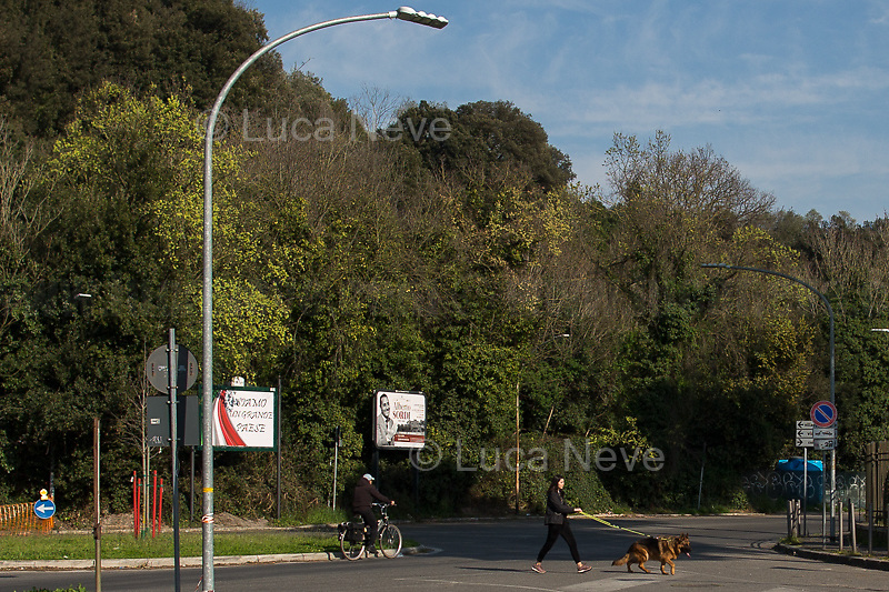 Take pets outside: allowed.<br /> <br /> Rome, 18/03/2020. Rome's Olympic Village district under the Italian Government lockdown for the Outbreak of the Coronavirus SARS-CoV-2 - COVID-19. On the 22nd March, the Italian PM Giuseppe Conte signed a new Decree Law which suspends non-essential industry productions and contains the list of allowed working activities, which includes Pharmaceutical & food Industry, oil & gas extraction, clothes & fabric, tobacco, transports, postal & banking services (timetables & number of agencies reduced), delivery, security, hotels, communication & info services, architecture & engineer, IT manufacturers & shops, call centers, domestic personnel (1.).<br /> Updates: Italy: 22.03.20, 6:00PM: 46.638 positive cases; 7.024 recovered; 5.476 died.<br /> <br /> The Rome's Olympic Village (1957-1960) was designed by: V. Cafiero, A. Libera, A. Luccichenti, V. Monaco, L. Moretti. «Built to host the approximately 8,000 athletes involved in the 1960 Olympic Games, Rome's Olympic Village is a residential complex located between Via Flaminia, the slopes of Villa Glori and Monti Parioli. It was converted into public housing [6500 inhabitants, ndr] at the end of the sporting event. The intervention is an example of organic settlement, characterized by a strong formal homogeneity, consistent with the Modern Movement's principles of urbanism. The different architectural structures are made uniform by the use of some common elements: the pilotis, ribbon windows, concrete stringcourses, and yellow brick curtain covering. At the center of the neighborhood, the Corso Francia viaduct - a road bridge about one kilometer long - was built by Pier Luigi Nervi […]» (2.).<br /> <br /> Info about COVID-19 in Italy: http://bit.do/fzRVu (ITA) - http://bit.do/fzRV5 (ENG)<br /> 1. March 22nd Decree Law http://bit.do/fFwJn (ITA)<br /> 2. (Atlantearchitetture.beniculturali.it MiBACT, ITA - ENG) http://bit.do/fFw3H<br /> 12.03.20 Rome's Lockdown for the Outbreak of the Cor