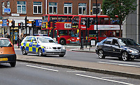 Silver 5 series BMW Metropoitan Police car on emergency call London UK.
