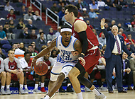 Washington, DC - March 10, 2018: Rhode Island Rams guard Stanford Robinson (13) drives to the basket during the Atlantic 10 semi final game between Saint Joseph's and Rhode Island at  Capital One Arena in Washington, DC.   (Photo by Elliott Brown/Media Images International)