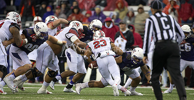 Daniela Tupou knocks the ball loose from Ute running back Devontae Booker.