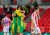 9th February 2019, bet365 Stadium, Stoke-on-Trent, England; EFL Championship football, Stoke City versus West Bromwich Albion; Ahmed Hegazy of West Bromwich Albion and Craig Dawson celebrate victory whilst Sam Vokes of Stoke City turns away in disappointment