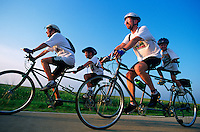 Family riding tandem bicycles in Ames, Iowa.