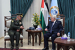 Palestinian President Mahmoud Abbas meets with major general Yousef al-Hilo, director of military training, at his headquarter, in the West Bank city of Ramallah, February 3, 2019. Photo by Thaer Ganaim