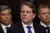 WASHINGTON, DC - SEPTEMBER 27:  White House Counsel Don McGahn listens to Judge Brett Kavanaugh as he testifies before the Senate Judiciary Committee during his Supreme Court confirmation hearing in the Dirksen Senate Office Building on Capitol Hill September 27, 2018 in Washington, DC. Kavanaugh was called back to testify about claims by Christine Blasey Ford, who has accused him of sexually assaulting her during a party in 1982 when they were high school students in suburban Maryland.  (Photo by Win McNamee/Getty Images)