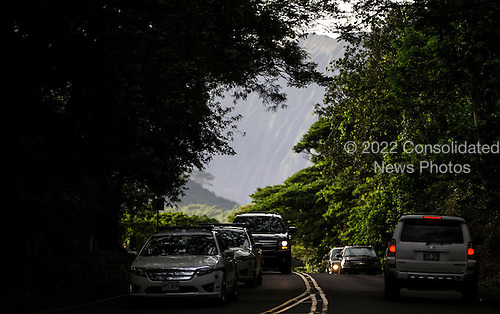 United States President Barack Obama's motorcade is seen departing for his vacation rental at Kailuana Place after hiking the Na Pohaku O Hauwahine trail off of Kapaa Quarry road on January 4, 2014 in Kailua, Hawaii. The Obamas are in Hawaii through the winter holiday and return to DC this weekend. <br /> Credit: Kent Nishimura / Pool via CNP