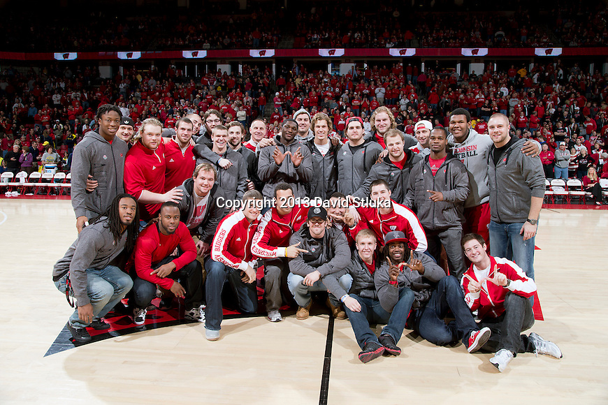 Wisconsin Badgers football team is honored at halftime during a Big Ten Conference NCAA college basketball game against the Michigan Wolverines Saturday, February 9, 2013, in Madison, Wis. The Badgers won 65-62 (OT). (Photo by David Stluka)