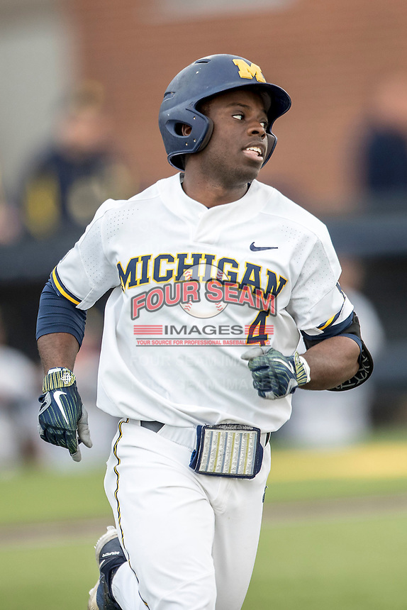 Michigan Wolverines second baseman Ako Thomas (4) runs to first base against the Maryland Terrapins on April 13, 2018 in a Big Ten NCAA baseball game at Ray Fisher Stadium in Ann Arbor, Michigan. Michigan defeated Maryland 10-4. (Andrew Woolley/Four Seam Images)