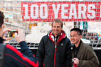 U.S. men's head coach Jurgen Klinsmann poses for a photograph with a fan during the centennial celebration of U. S. Soccer at Times Square in New York, NY, on April 04, 2013.