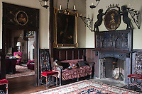 A view into the music room from the staircase hall, with its Jacobean fireplace and portrait of Endymion Porter by van Dyck