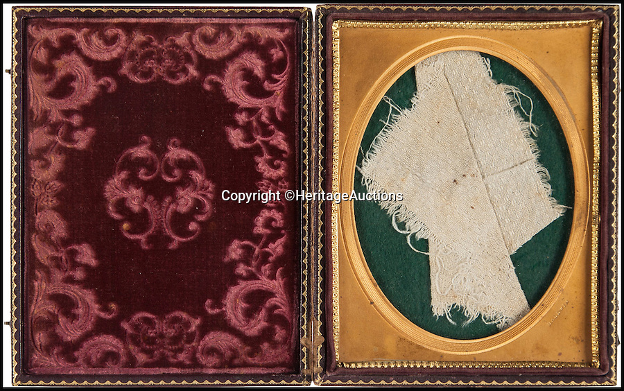 BNPS.co.uk (01202 558833)<br /> Pic: HeritageAuctions/BNPS<br /> <br /> A blood-stained section of towel that was used to bind the wound of President Lincoln. <br /> <br /> Gruesome souvenirs taken following Abraham Lincoln's assassination are set to be sold at a macabre auction in the US. <br /> <br /> A blood stained towel used to bind the president's wound moments after he was gunned down in Ford's theatre by actor John Wilkes Booth, as well as locks of both men's hair are among a set of grim lots tipped to fetch tens of thousands of pounds.<br /> <br /> It was in April 1865 that Booth burst into the civil war leader's private box during a performance of Our American Cousin, which was being watched by an audience of 1,500, and fired into Lincoln's head at point blank range. <br /> <br /> And 151 years later some of the more unusual remnants from that fateful night and its immediate aftermath will be sold by Heritage Auctions on September 17.