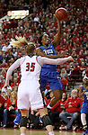 VERMILLION, SD, APRIL 2:  DyTiesha Dunson #0 from Florida Gulf Coast takes the ball to the basket past Nicole Seekamp #35 from the University of South Dakota during the WNIT Championship game Saturday afternoon at the Dakota Dome in Vermillion, S.D. (Photo by Dave Eggen/Inertia)
