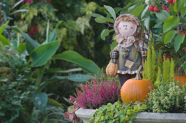 Garden Decoration, girl, pumpkin, fall, Oberaegeri, Switzerland, August 2006