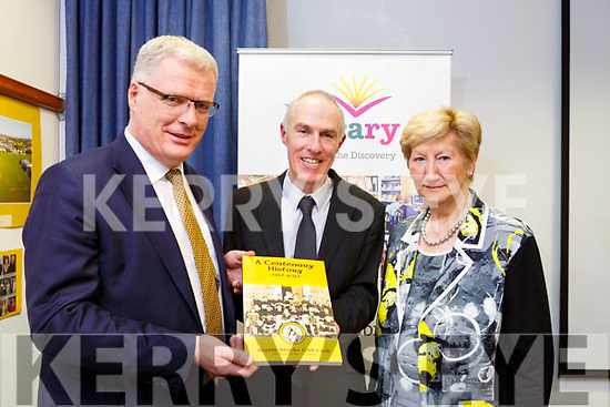 """Liam Lynch (Chairman of Austin Stacks GAA) makes a presentation to Tommy O'Connor (County Librarian) with Mairead Fernane (Vice Chair) of the clubs book """"A Centenary History"""" at the launch of the clubs photographic exhibition in the Kerry County Library on Tuesday night last."""