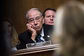 UNITED STATES - SEPTEMBER 27: Chairman Charles Grassley, R-Iowa, listens to Dr. Christine Blasey Ford testify during the Senate Judiciary Committee hearing on the nomination of Brett M. Kavanaugh to be an associate justice of the Supreme Court of the United States, focusing on allegations of sexual assault by Kavanaugh against Christine Blasey Ford in the early 1980s. (Photo By Tom Williams/CQ Roll Call/POOL)