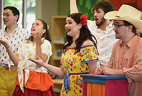 NWA Democrat-Gazette/DAVID GOTTSCHALK Jordan Knapick (center), with the Studio Artists of Opera in the Ozarks, performs as Maria Thursday, July 11, 2019, in the children's opera Monkey See, Monkey Do at the Springdale Library. Children in the audience received an opera related activity book. The artists will perform at the Bentonville Public Library on Saturday, July 13th at 2:00 p.m..