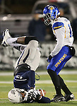 Nevada's Hasaan Henderson (12) tries to hold onto the ball against San Jose State's Forrest Hightower (12) during the first half of an NCAA college football game in Reno, Nev., on Saturday, Nov. 16, 2013.<br /> (AP Photo/ Cathleen Allison).
