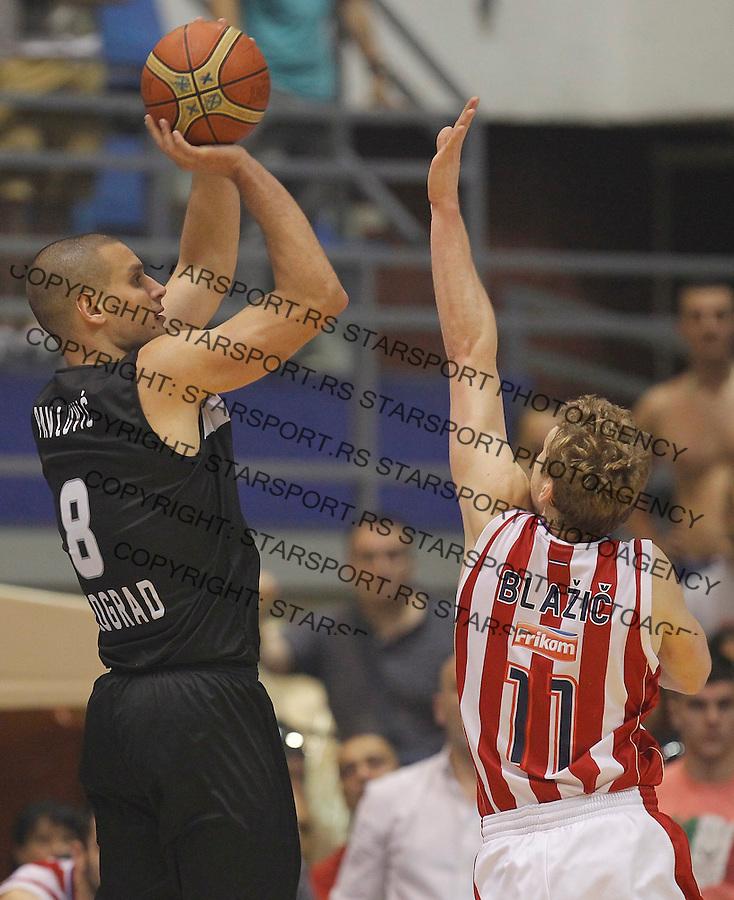 Kosarka play off final game 4<br /> Crvena Zvezda v Partizan<br /> Aleksandar Pavlovic (L) and Jaka Blazic<br /> Belgrade, 06.21.2014.<br /> foto: Srdjan Stevanovic/Starsportphoto &copy;