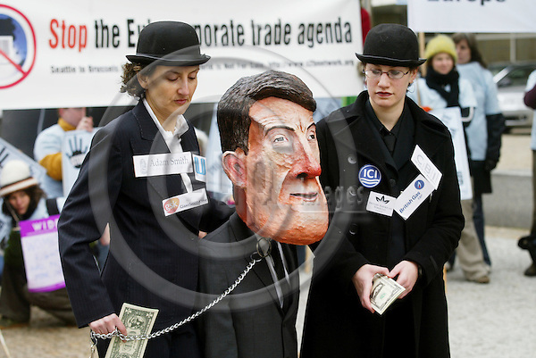 """BRUSSELS - BELGIUM - 21 NOVEMBER 2005 -- A Peter Mandelson puppet operated by """"European big business"""" to reveal the role of corporate lobbyist in setting the EU Trade agenda outside the EU Commission headquarters as a part of a  demonstration under the slogan Stop The EU Corporate Trade Agenda.  PHOTO: ERIK LUNTANG / EUP-IMAGES.."""