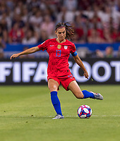LYON,  - JULY 2: Alex Morgan #13 passes during a game between England and USWNT at Stade de Lyon on July 2, 2019 in Lyon, France.