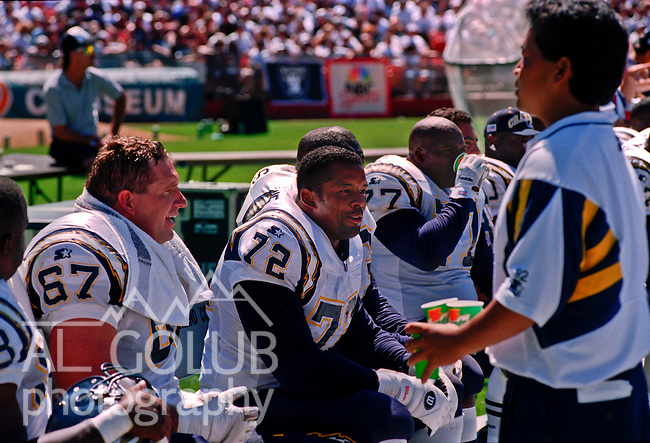 Oakland Raiders vs. San Diego Chargers at Oakland Alameda County Coliseum Sunday, September 3, 1995.  Raiders beat Chargers  17-7.  San Diego Chargers tackle Stan Brock (67) and tackle Harry Swayne (72) talk on the bench.