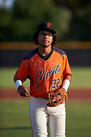 AZL Giants Orange third baseman Luis Toribio (22) jogs off the field between innings of an Arizona League game against the AZL Mariners on July 18, 2019 at the Giants Baseball Complex in Scottsdale, Arizona. The AZL Giants Orange defeated the AZL Mariners 7-4. (Zachary Lucy/Four Seam Images)