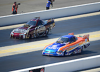 Apr. 14, 2012; Concord, NC, USA: NHRA top alcohol funny car driver Todd Veney (near lane) races alongside Frank Manzo during qualifying for the Four Wide Nationals at zMax Dragway. Mandatory Credit: Mark J. Rebilas-