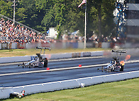 Jun 6, 2015; Englishtown, NJ, USA; NHRA top fuel driver Dave Connolly (right) races alongside teammate Larry Dixon during qualifying for the Summernationals at Old Bridge Township Raceway Park. Mandatory Credit: Mark J. Rebilas-
