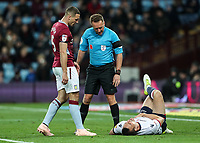 Bolton Wanderers' Jack Hobbs lies injured as Aston Villa's James Chester and referee Oliver Longford look on<br /> <br /> Photographer Andrew Kearns/CameraSport<br /> <br /> The EFL Sky Bet Championship - Aston Villa v Bolton Wanderers - Friday 2nd November 2018 - Villa Park - Birmingham<br /> <br /> World Copyright &copy; 2018 CameraSport. All rights reserved. 43 Linden Ave. Countesthorpe. Leicester. England. LE8 5PG - Tel: +44 (0) 116 277 4147 - admin@camerasport.com - www.camerasport.com