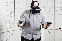 Guillermo Bernal demonstrates the PhysioHMD project used with the virtuality experience he worked on called EmotionalBeasts in the Fluid Interfaces Group lab space at MIT's Media Lab in Cambridge, Massachusetts, USA, seen here on Tues., April 25, 2017. Bernal is a grad student and research assistant in the Fluid Interfaces Group, led by Pattie Maes. The system uses sensors to detect physiological changes including body temperature and skin resistance as they occur during the VR experience.