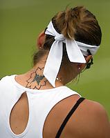 28-06-12, England, London, Tennis , Wimbledon, Tatoo on the back of Shvedova