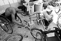 Athletes are checking their wheelchair one last time before heading to the race spot in the center of Phnom Penh, Cambodia - 2008