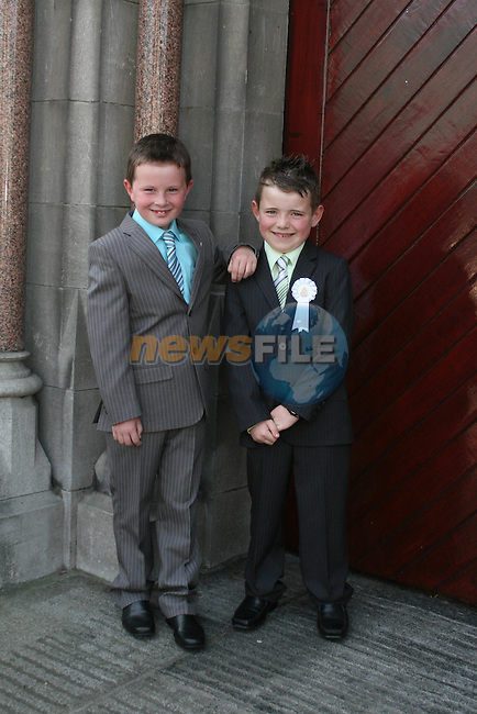 Neighbours, Pádraic Downey and Conor Tiernan at the St. Marys Congress Avenue Communion in St. Marys Church...Photo NEWSFILE/Jenny Matthews.(Photo credit should read Jenny Matthews/NEWSFILE)....This Picture has been sent you under the condtions enclosed by:.Newsfile Ltd..The Studio,.Millmount Abbey,.Drogheda,.Co Meath..Ireland..Tel: +353(0)41-9871240.Fax: +353(0)41-9871260.GSM: +353(0)86-2500958.email: pictures@newsfile.ie.www.newsfile.ie.FTP: 193.120.102.198.