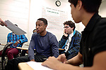 Ryan Holder, center, a student at Montgomery College, reacts to being presented with a final project in his Basic Writing II class at the Takoma Campus on Dec. 11, 2012. If students pass this class, it allows them to progress to the college level english program. Otherwise students will face the decision to take the remedial class again or drop out.