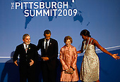 Pittsburgh, PA - September 24, 2009 -- United States President Barack Obama (2L) welcomes Brazilian President Luiz Inacio Lula da Silva (L) to the welcoming dinner for G-20 leaders as U.S. first lady Michelle Obama (R) talks with Brazilian first lady Marisa Leticia Lula da Silva at the Phipps Conservatory on Thursday, September 24, 2009 in Pittsburgh, Pennsylvania. Heads of state from the world's leading economic powers arrived today for the two-day G-20 summit held at the David L. Lawrence Convention Center aimed at promoting economic growth.  .Credit: Win McNamee / Pool via CNP