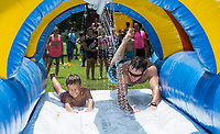 NWA Democrat-Gazette/BEN GOFF @NWABENGOFF<br /> Hayden Fry, 10, of Rogers and Derek Sallee, director of older camps, dive onto a water slide Tuesday, Aug. 6, 2019, during the Summer Day Camp at the Rogers Activity Center. This week's camp is the center's final session of the summer season.