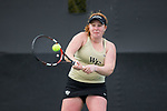 Chandler Carter of the Wake Forest Demon Deacons returns the ball during the match against the North Carolina Tar Heels at the Wake Forest Tennis Center on March 29, 2017 in Winston-Salem, North Carolina. The Tar Heels defeated the Demon Deacons 6-1.  (Brian Westerholt/Sports On Film)