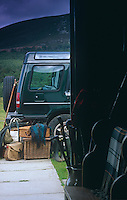 A wicker picnic hamper and other bags sit waiting to be put into the Land Rover for a day out on the hills