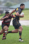 Zac Makavilitogia  pushes off the tackle of Lepa Taveli. Counties Manukau Premier Club Rugby game between Papakura & Bombay played at Massey Park Papakura on Saturday May 30th 2009..Bombay won 57 - 7 after leading 24 - 0 at halftime.