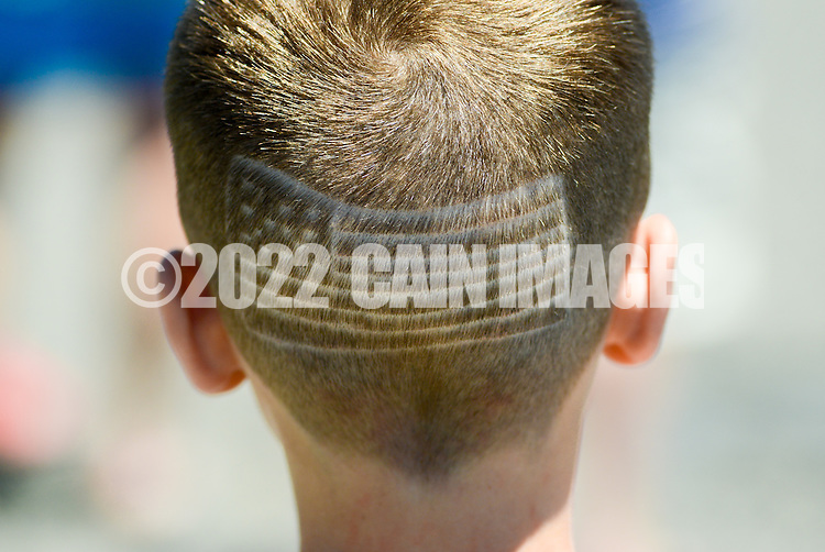A young boy shows off his American Flag haircut during the Independence Parade Saturday July 2, 2016 on Beach Avenue in Cape May, New Jersey. Photo by William Thomas Cain/Cain Images