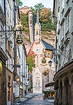 View of the St. Blasius Catholic Church at the end of the Getreidegasse in Salzburg, Austria