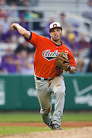 Auburn Tigers third baseman Damek Tomscha #25 makes a throw to first base against the LSU Tigers in the NCAA baseball game on March 23, 2013 at Alex Box Stadium in Baton Rouge, Louisiana. LSU defeated Auburn 5-1. (Andrew Woolley/Four Seam Images).