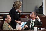 Nevada Sens. Justin Jones, Barbara Cegavske and Mark Hutchison work on the Senate floor at the Legislative Building in Carson City, Nev., on Monday, March 11, 2013..Photo by Cathleen Allison