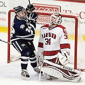 Stevie Moses (UNH - 22), Steve Michalek (Harvard - 34) - The Harvard University Crimson defeated the University of New Hampshire Wildcats 7-6 on Tuesday, November 22, 2011, at Bright Hockey Center in Cambridge, Massachusetts.