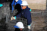 Scottsdale, Arizona (January 12, 2013) - As part of a seven-year plan to dry up all portions of its 131-mile canal system, Salt River Project (SRP), relocated the White Amur fish they used as an environmentally friendly and cost effective alternative to herbicides and heavy machinery for vegetation control. In this image, workers set up wire fence to begin corralling fish towards a collection point. Photo by Eduardo Barraza © 2013