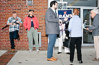 Staff and supporters of Kentucky senator and Republican presidential candidate Rand Paul wait outside Norton's Classic Cafe for the candidate's arrival in Nashua, New Hampshire. Paul greeted people at the diner before a group of campaign volunteers canvassed Nashua-area neighborhoods.At left, with camera, is a candidate tracker who follows Republican candidates around the state for opposition research.